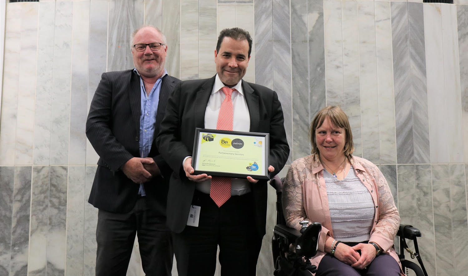 Be Welcome Team handing Platinum rating to Parliament
