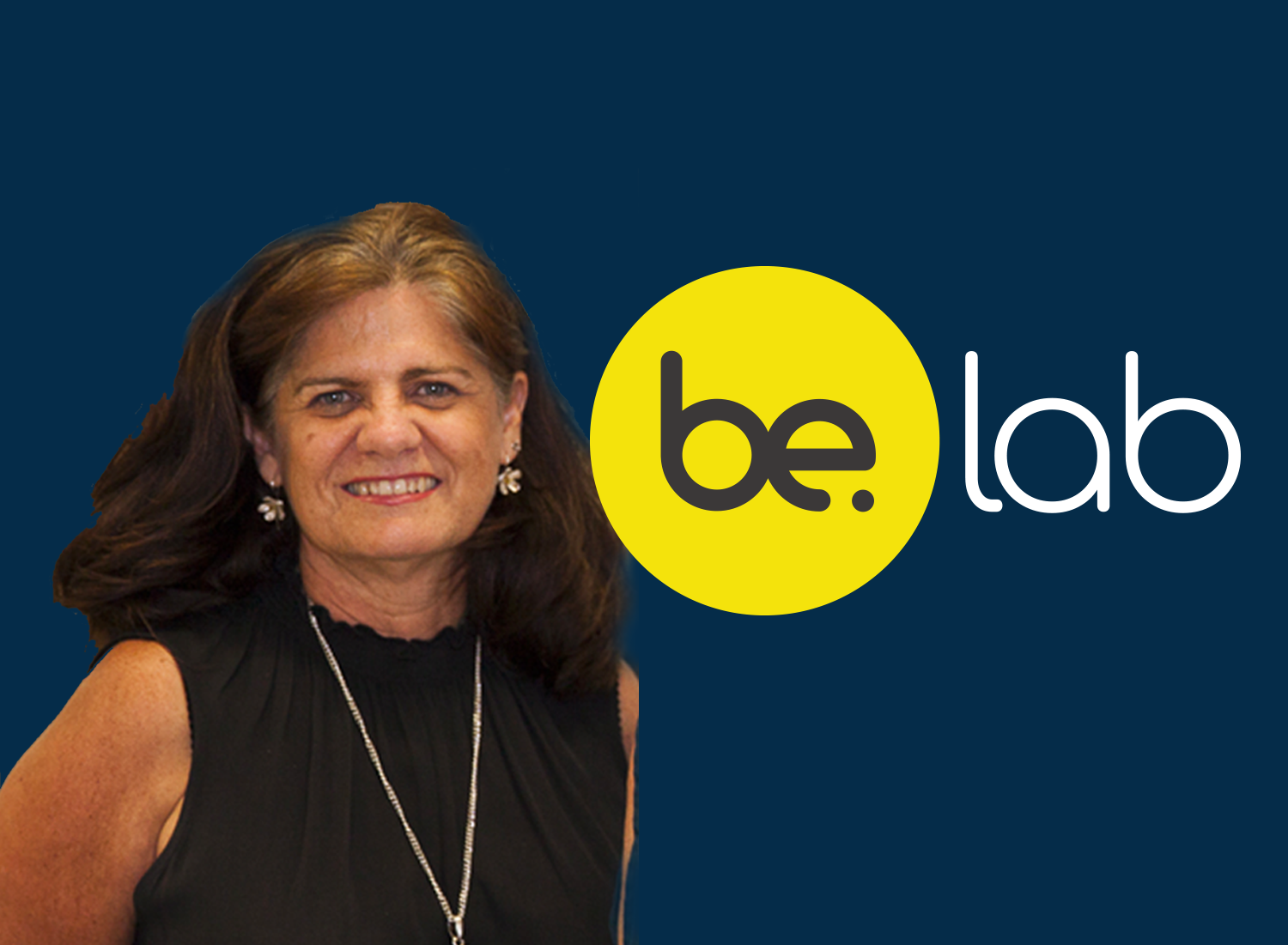 Headshot of Be. Lab CEO, Sue Russell next to the Be. Lab logo on a navy blue background