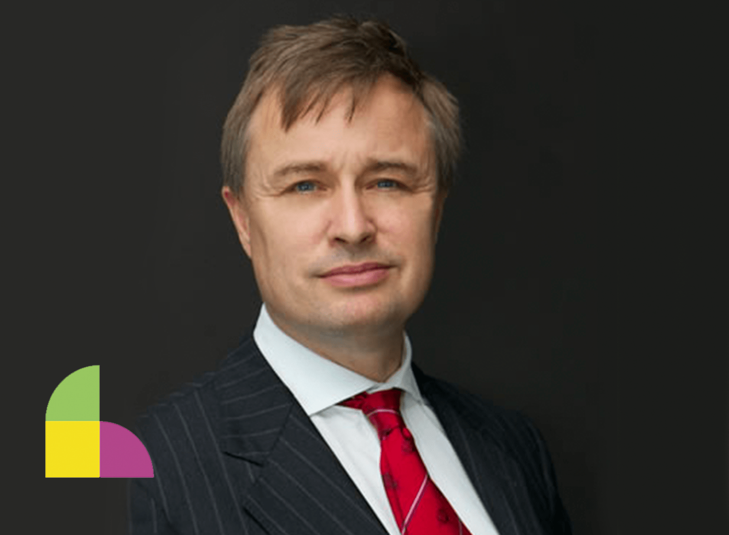 An image of John Allen, Chair of the Be. Institute, with a yellow, green, and pink icon in the bottom left hand corner, representing the concept of leadership