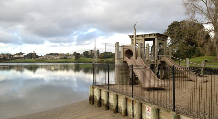 A picture of Auckland's Panmure Basin with a playground in the foreground