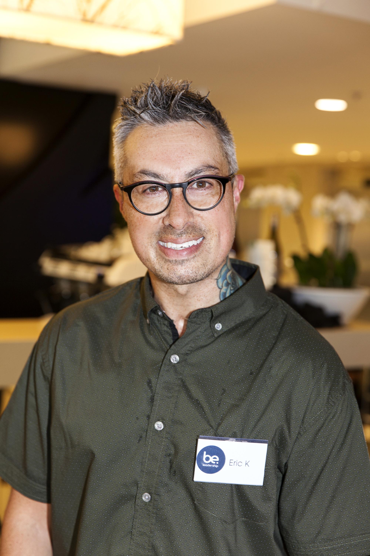 Eric Knapp smiling at the camera wearing a dark green shirt