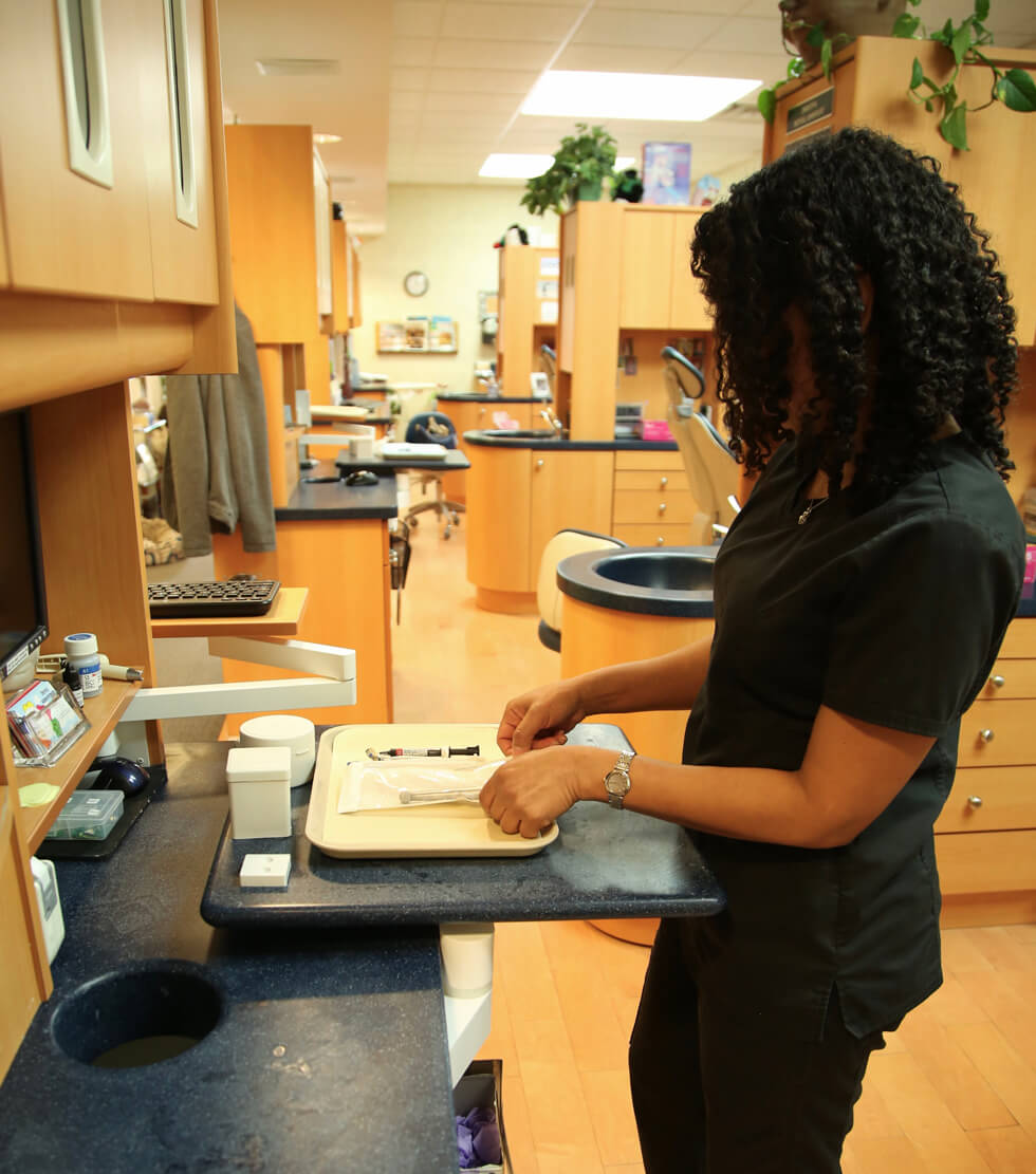 Woman setting up dental tray