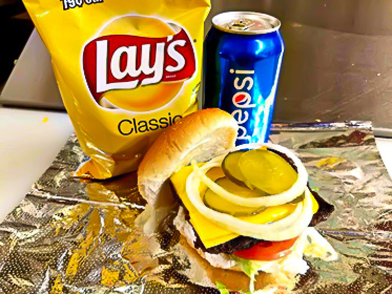 Cheeseburger with pickles and onions