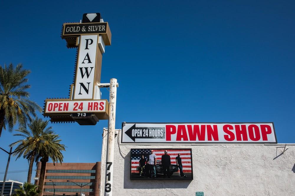 Pawn shop signage on a blue sky
