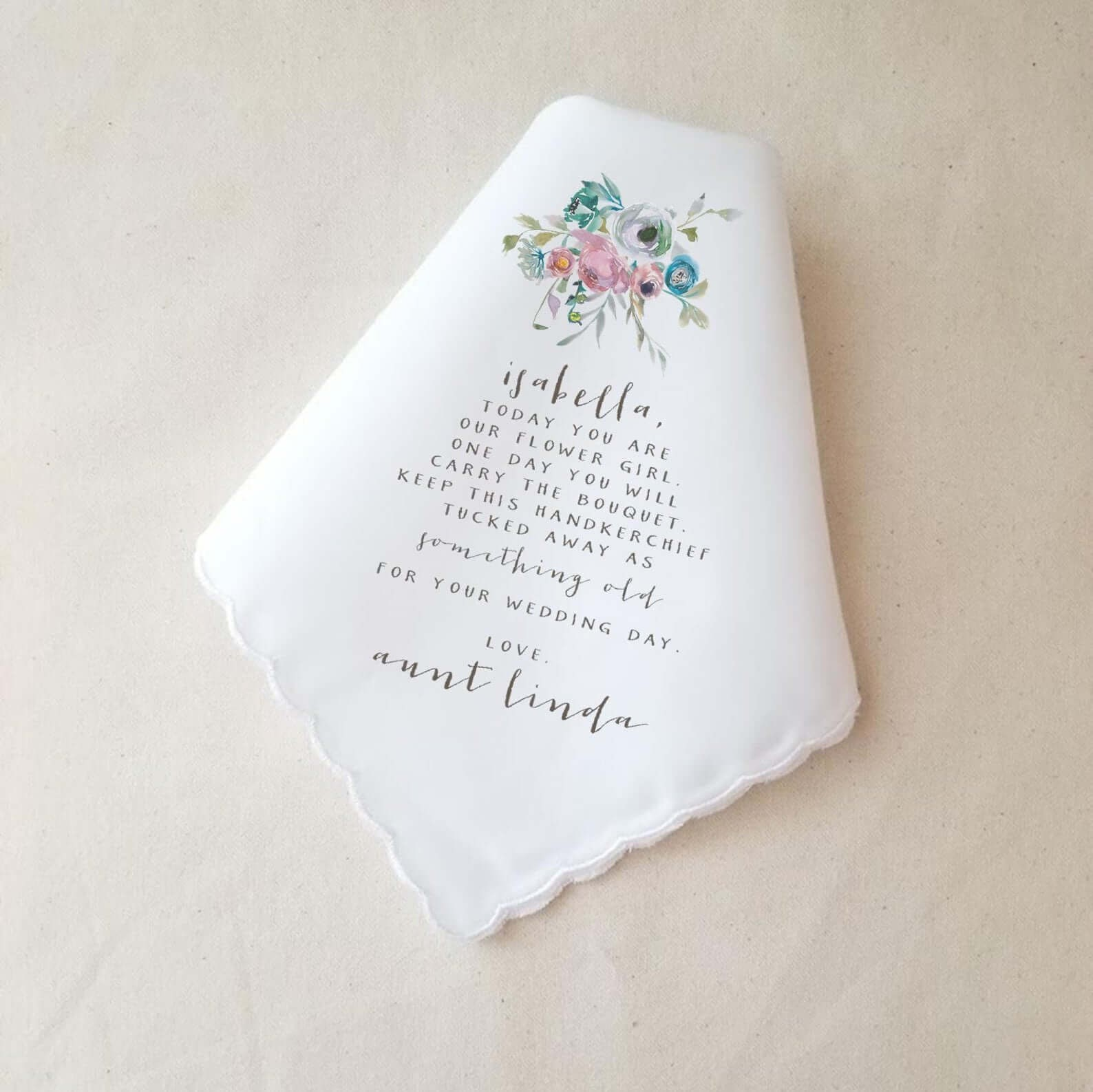 Beautiful printed handkerchief that points to the flower girl's future wedding day'