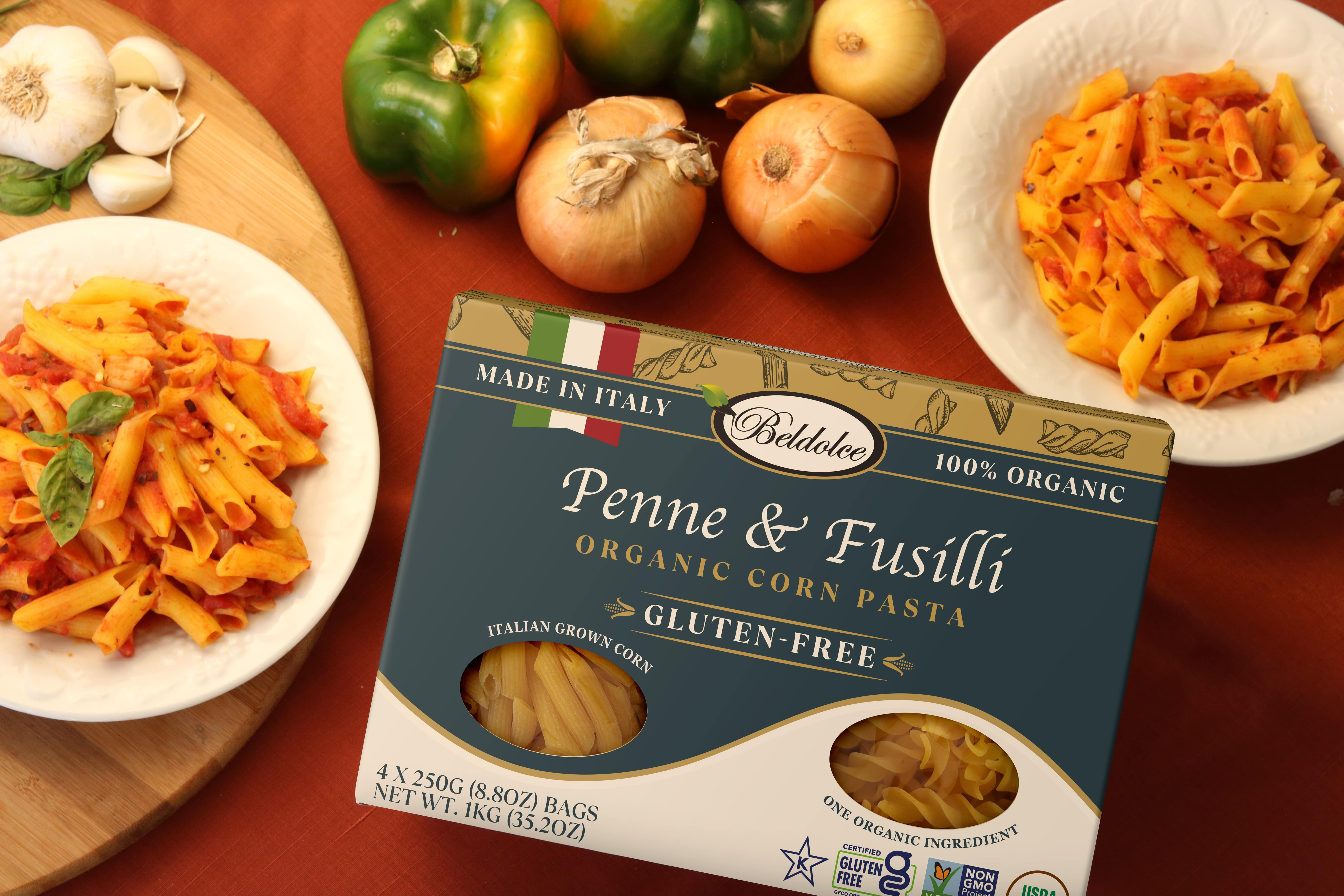 Penne & Fusilli Package surrounded by Italian vegetables and two dishes of freshly Beldolce pasta.