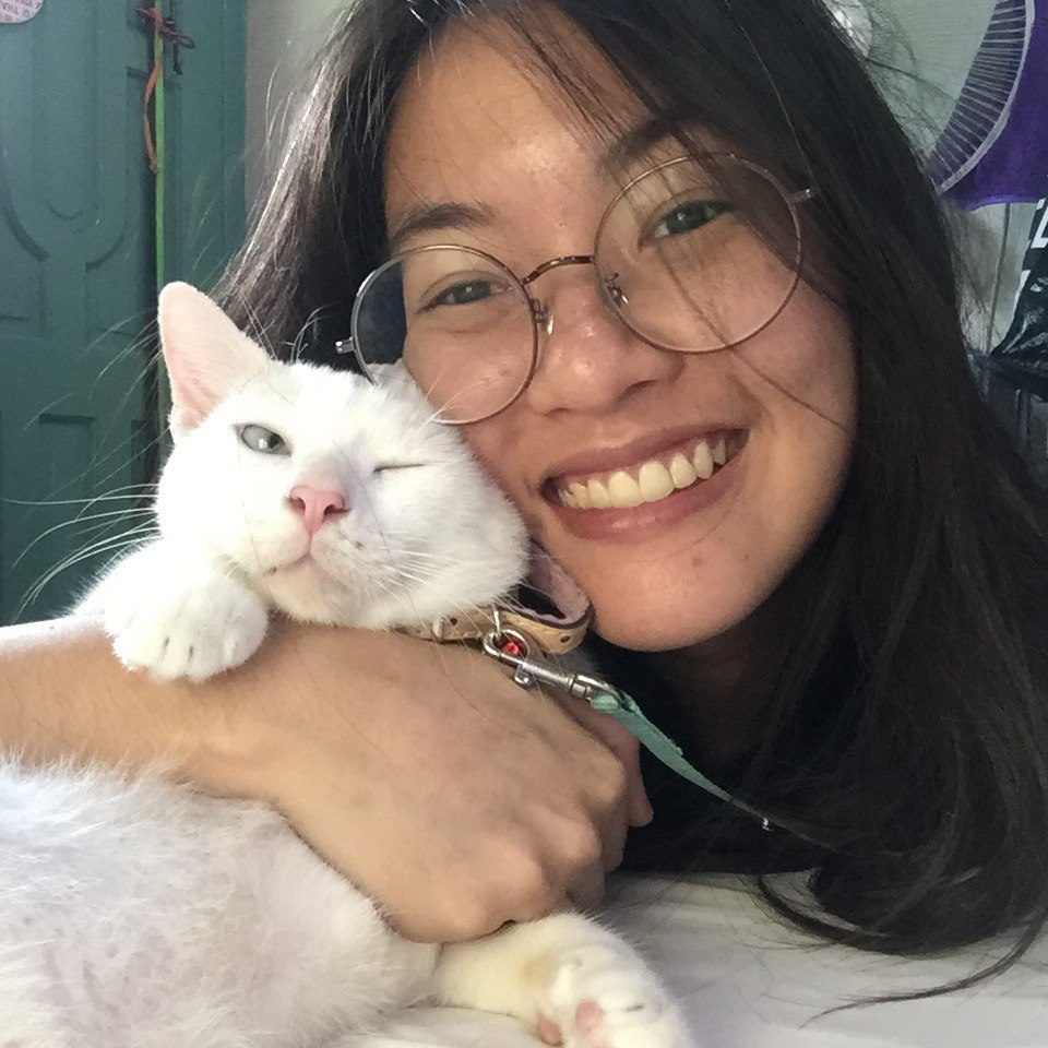 A photo of me together with my odd-eyed white pet kitty.