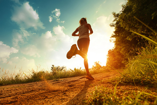 Running toward sun through a field for mental clarity.