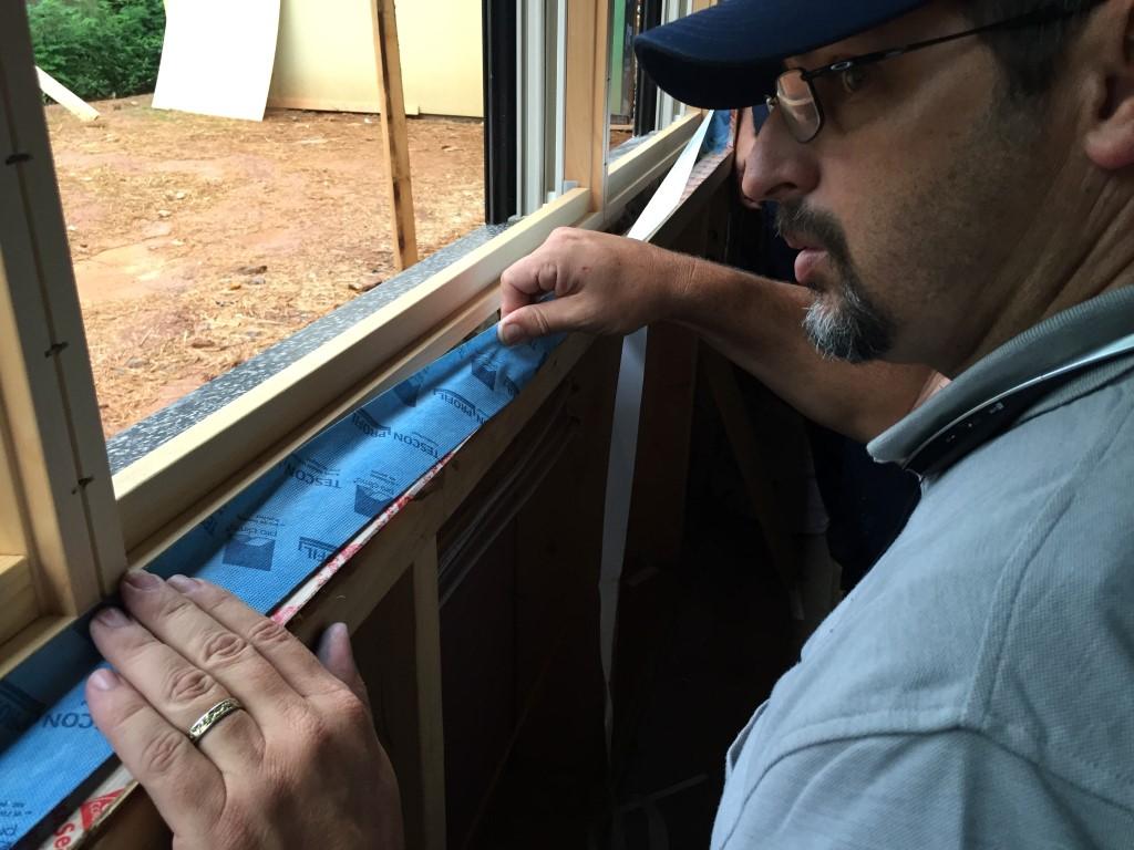 High Performance Bungalow Installing Air Sealing Tape