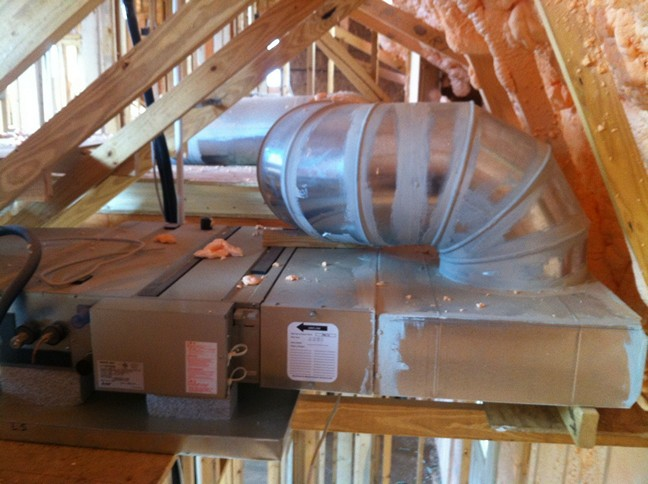 Ducted mini-split fan coil in attic before insulation