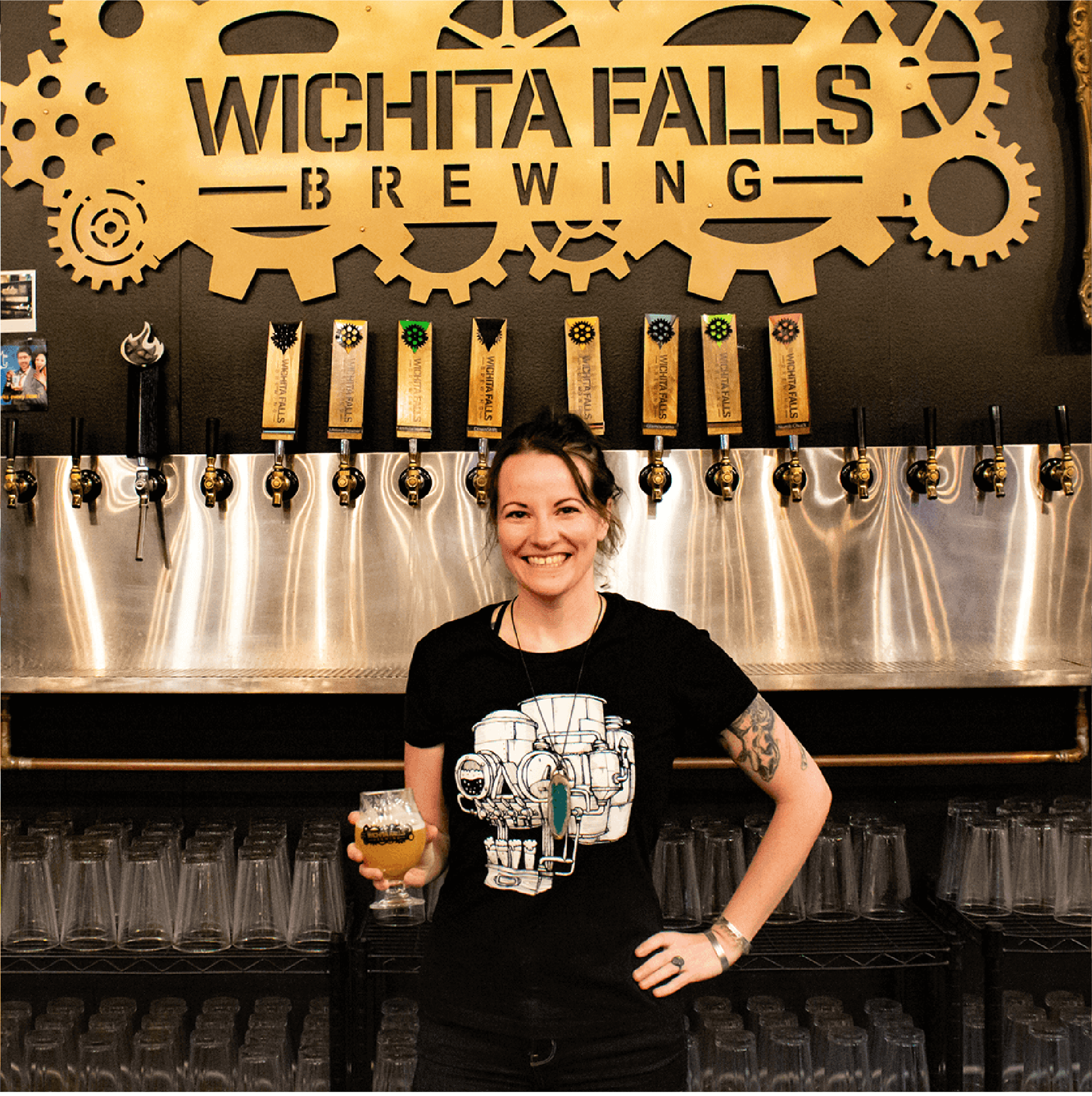 Katrina, our social-media and beer tender, stands in her favorite spot behind the bar, ready to serve you an amazingly delicious beer