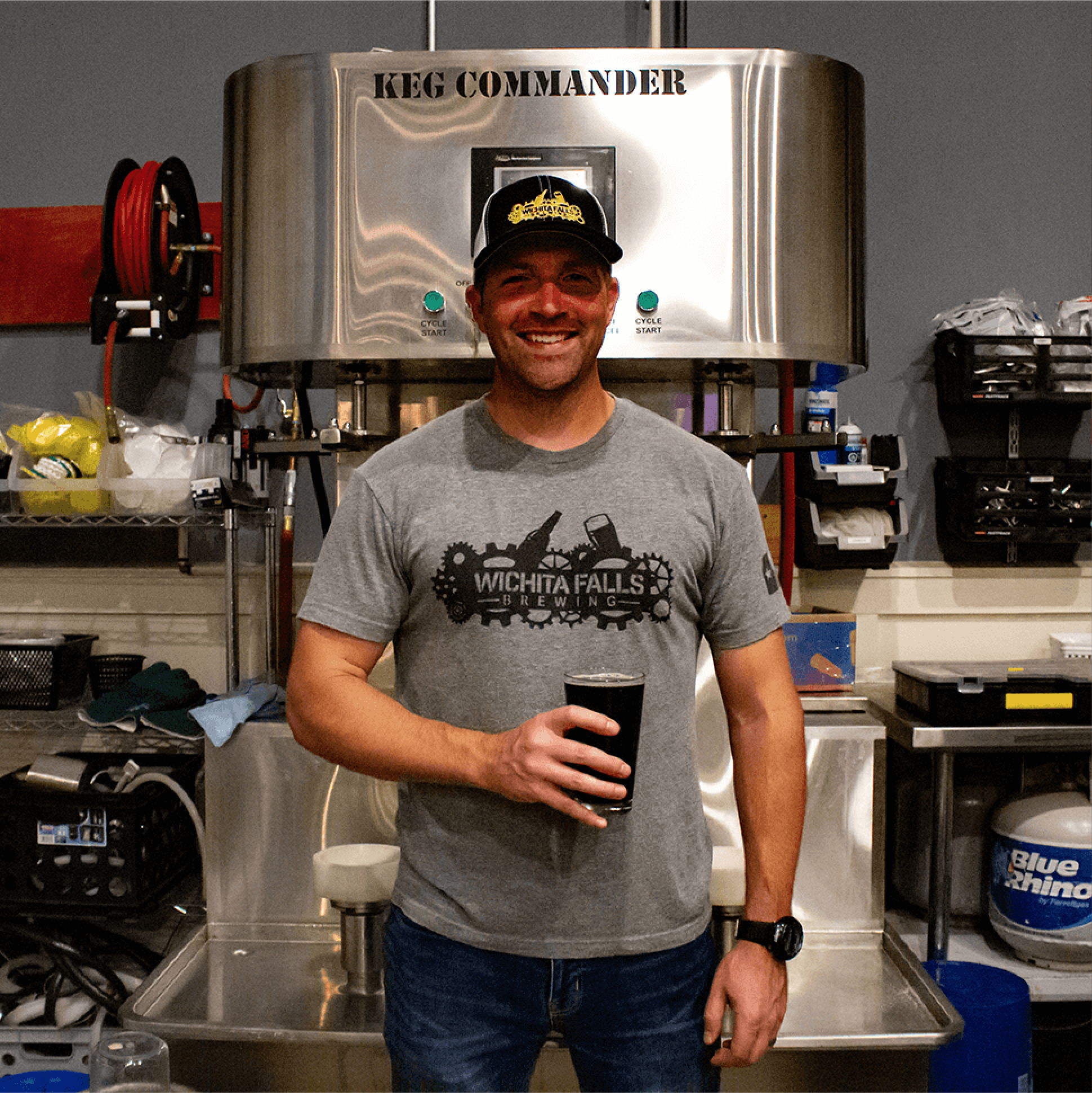 Russ, our Vice President and Co-Founder standing beer in hand in front of our Keg Commander