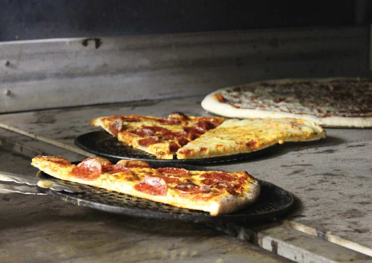 SERVING PIZZA FROM THE OVEN