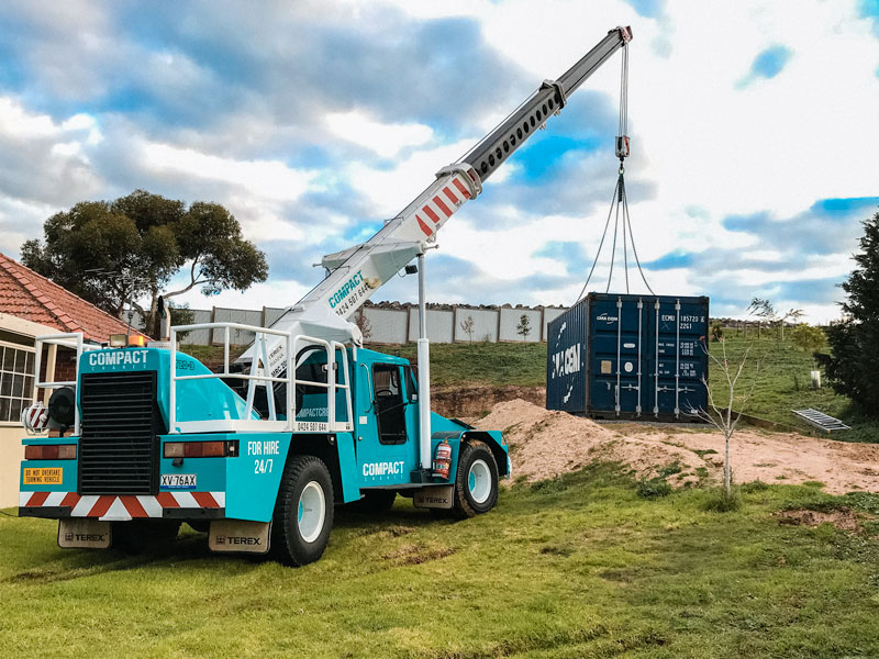 Franna crane lifting shipping container