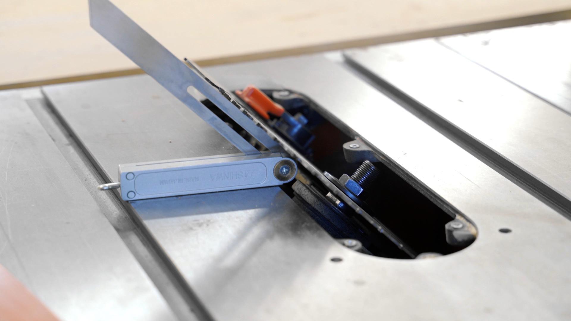 Check angle of table saw with an angle gauge
