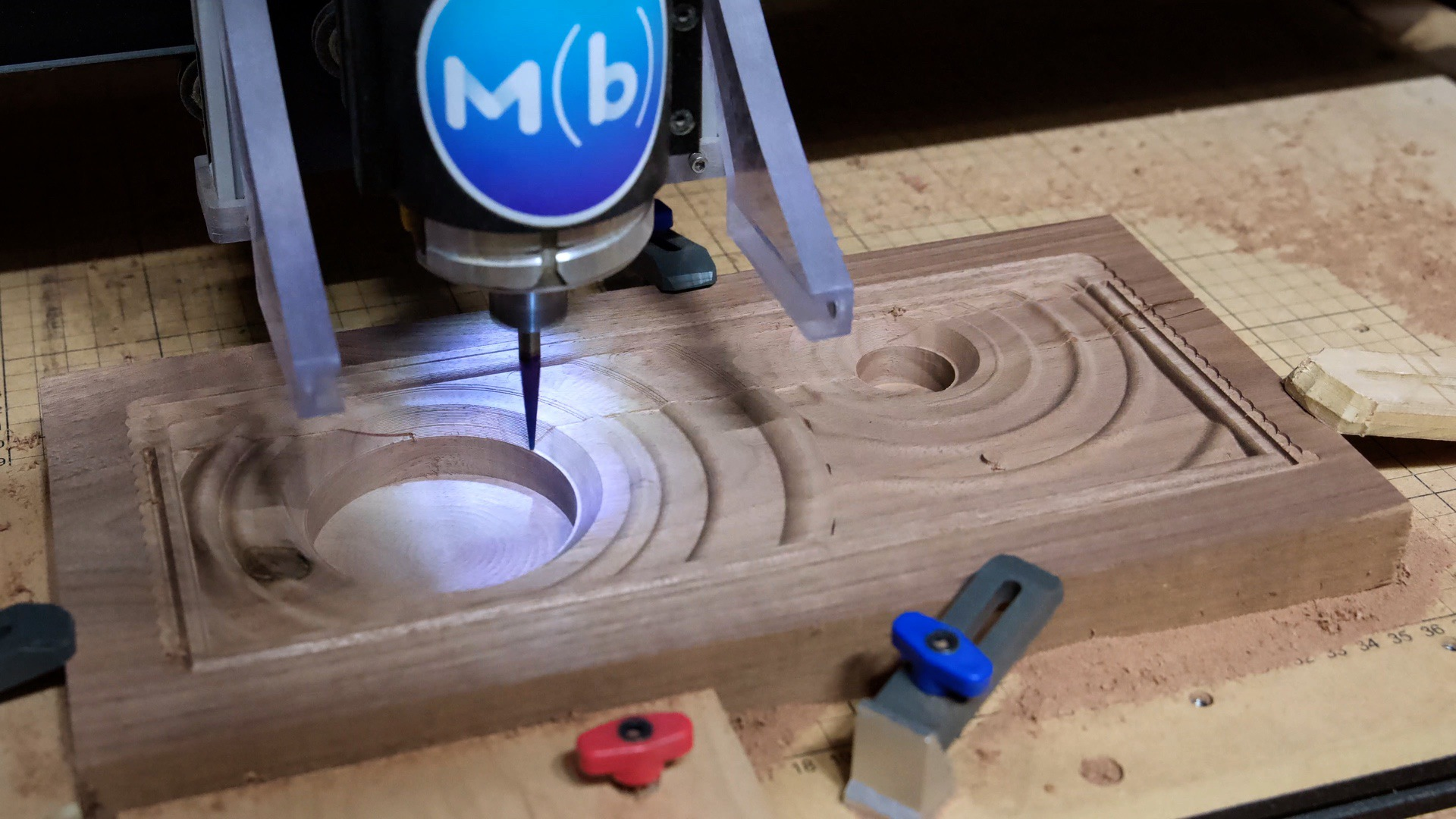 Carve the walnut Bluetooth speaker face out on the CNC