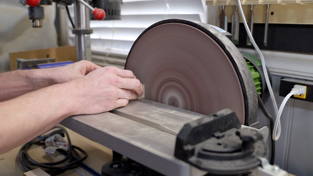 Use a disk sander to sand dresser drawers to final size