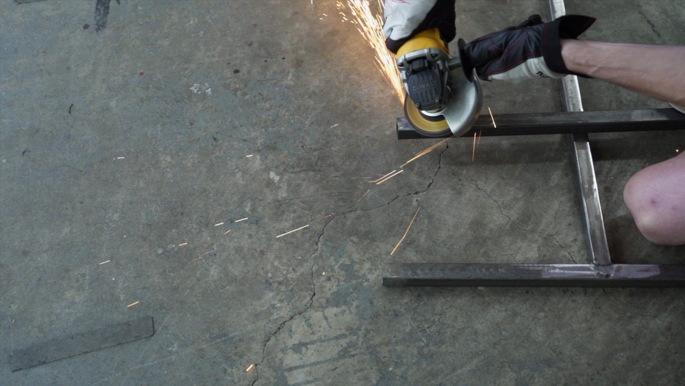 Grind the ends of the metal to prep for welding