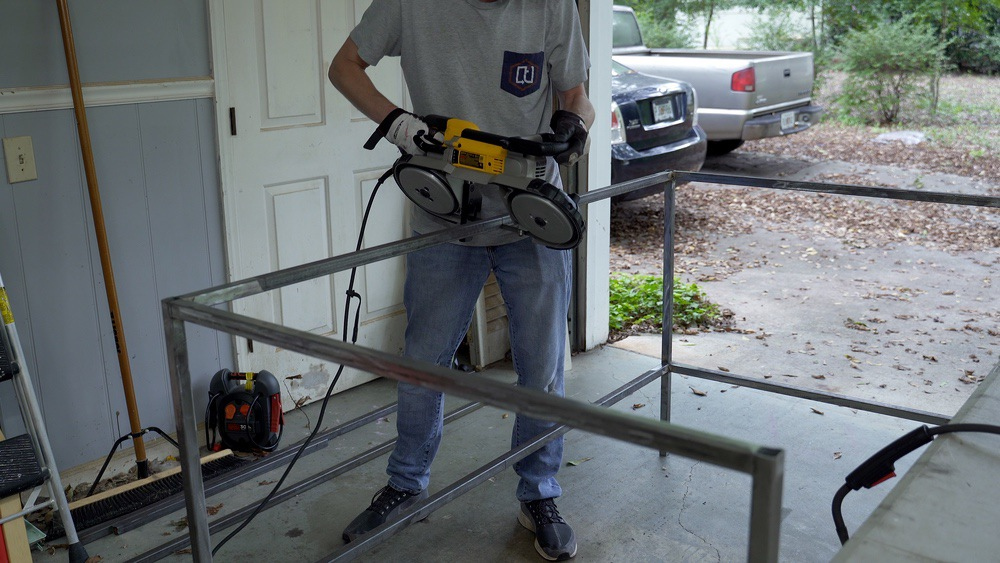 Cutting the bed frame with a portable band saw