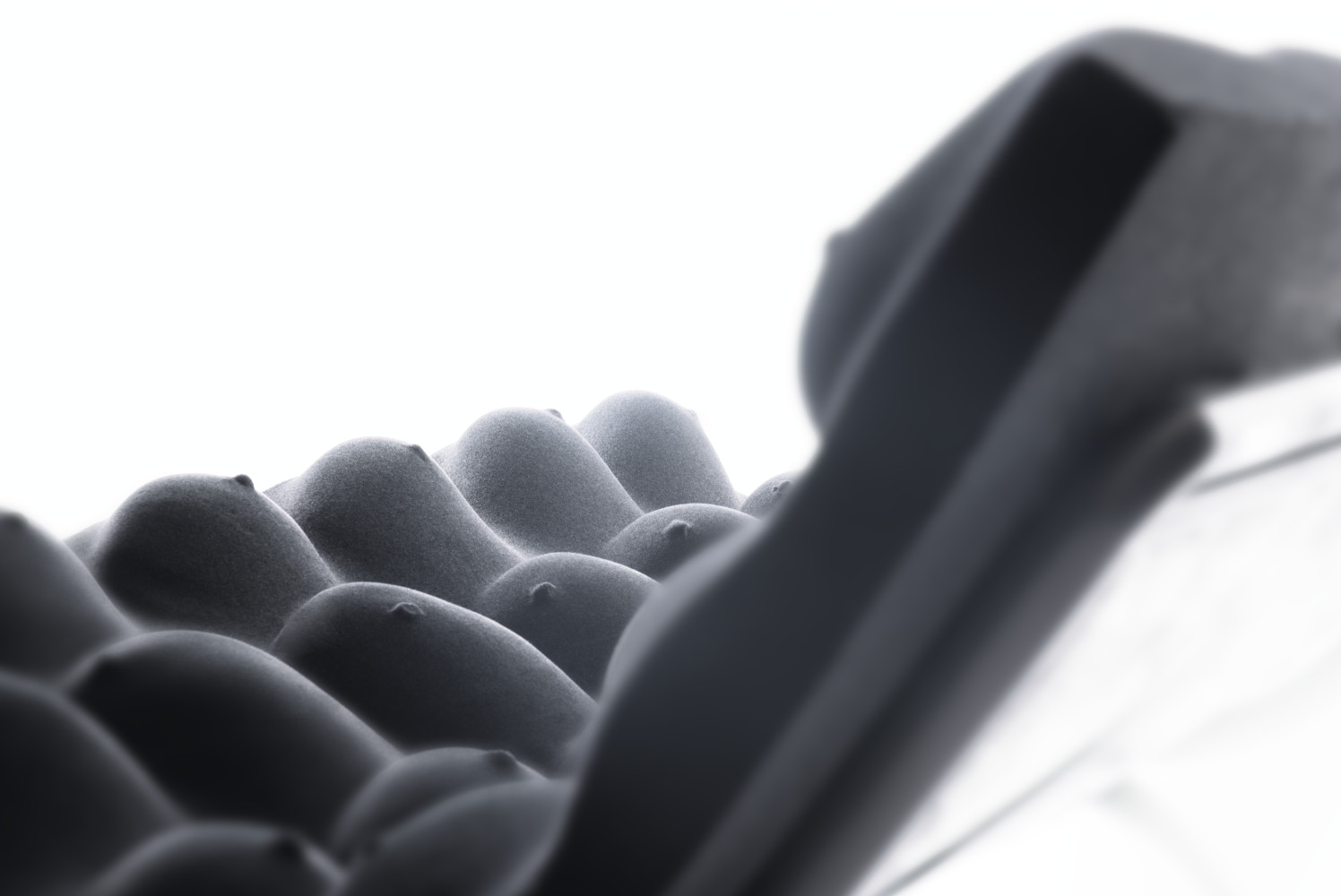 Detail of boobs on Meanwhile sofa. Casted woman breast.