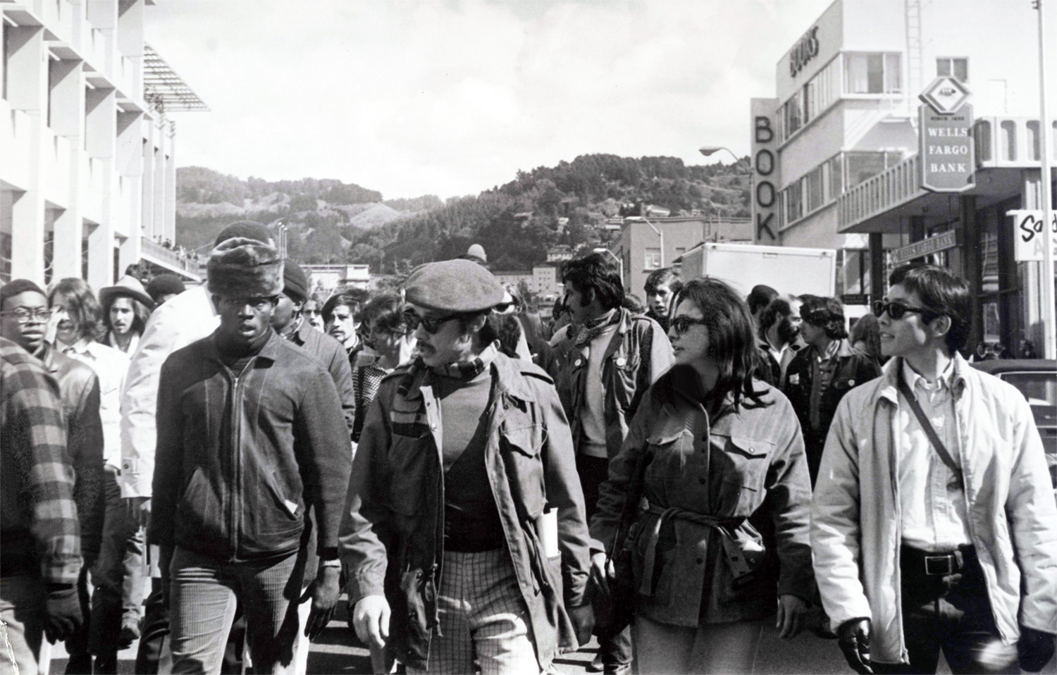 Students activists from four University of California, Berkeley ethnic student groups protesting on a street.