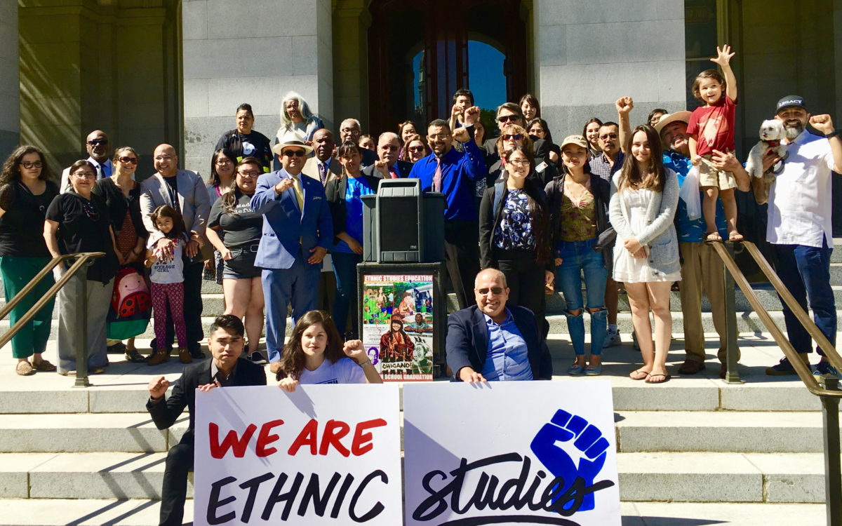 People attending a press conference in support of the ethnic studies graduation requirement at California State University.