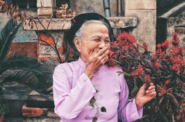 Elder Asian woman laughing and happy