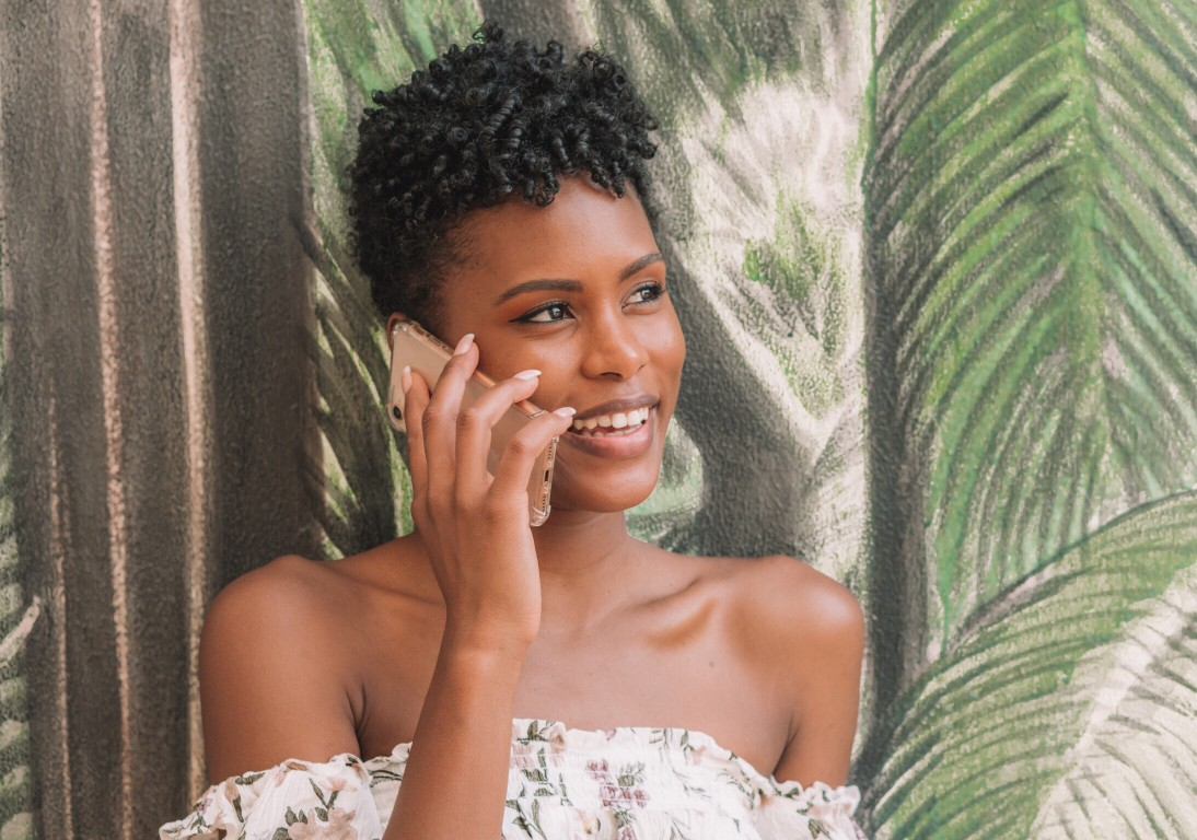 Happy Black Woman On The Phone