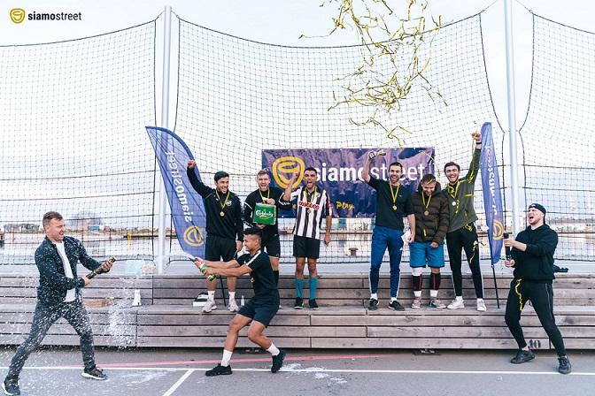 Football players on podium winning the siamo street cup