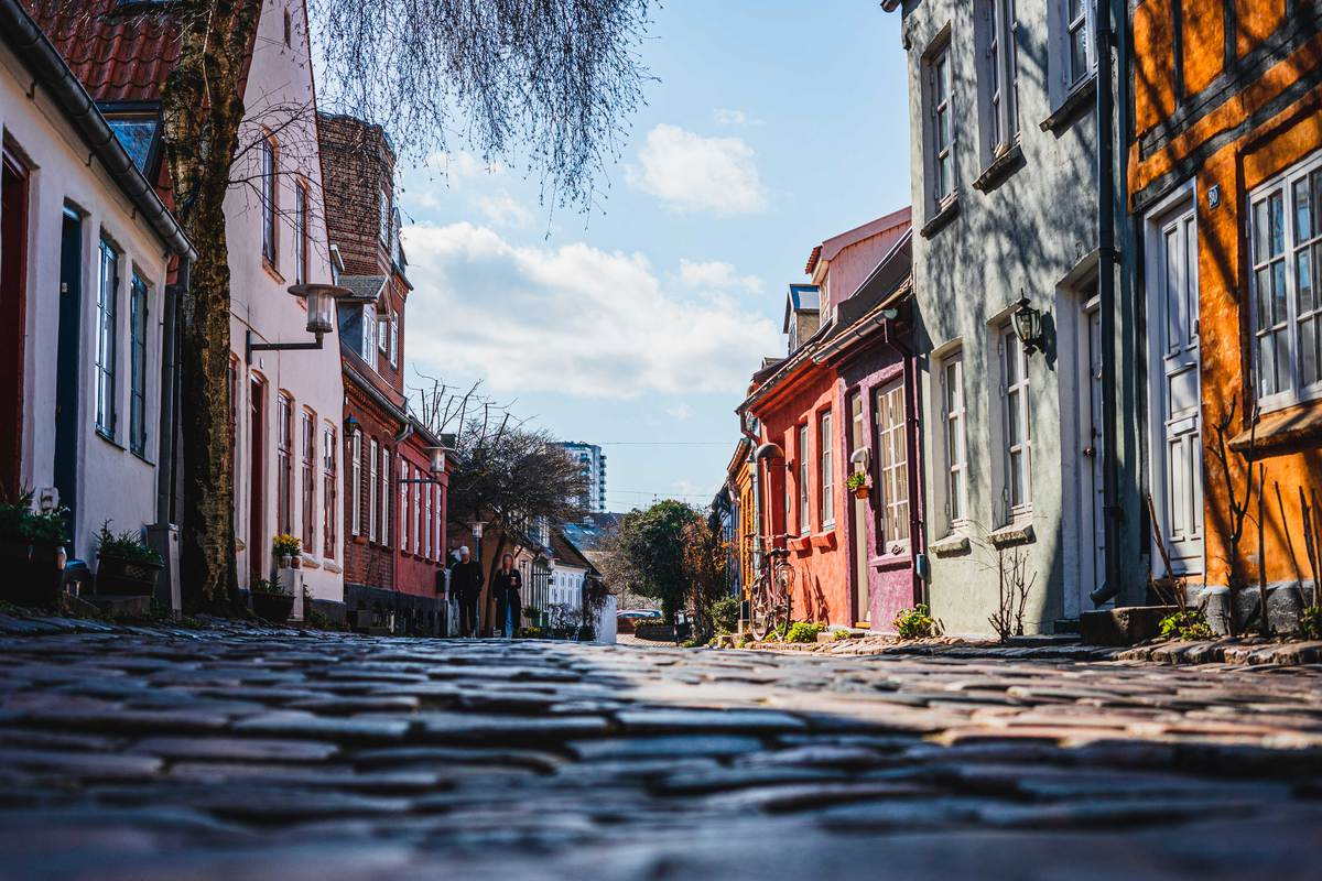 Stone paved street surrounded by colorful houses