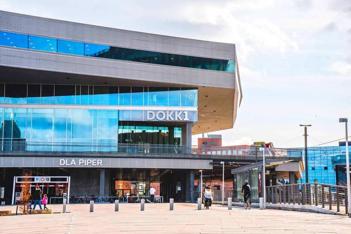 The Dokk1 building with tram station next to it
