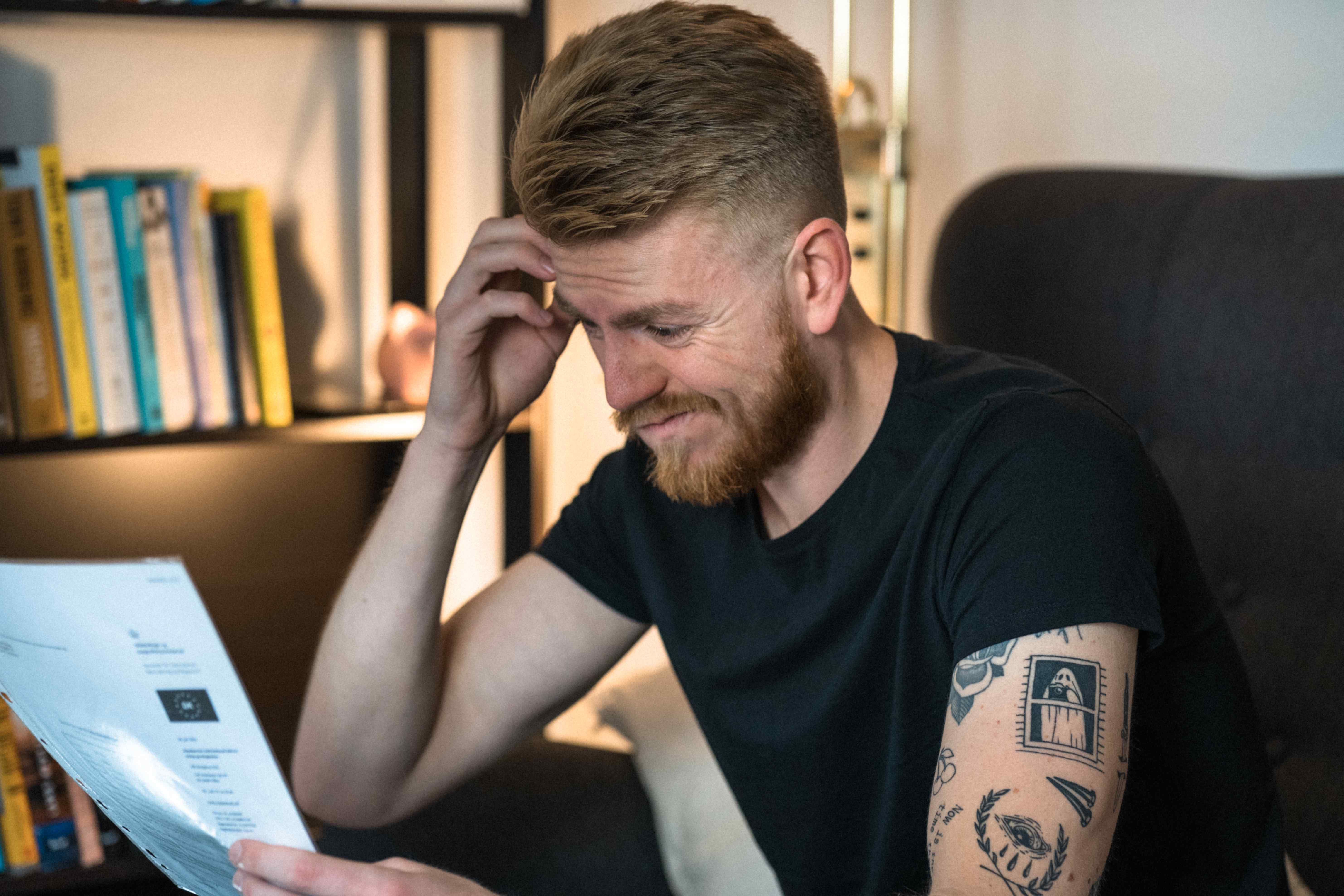 Frustrated student reading his employment contract