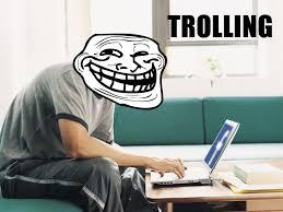 Internet troll behind laptop.