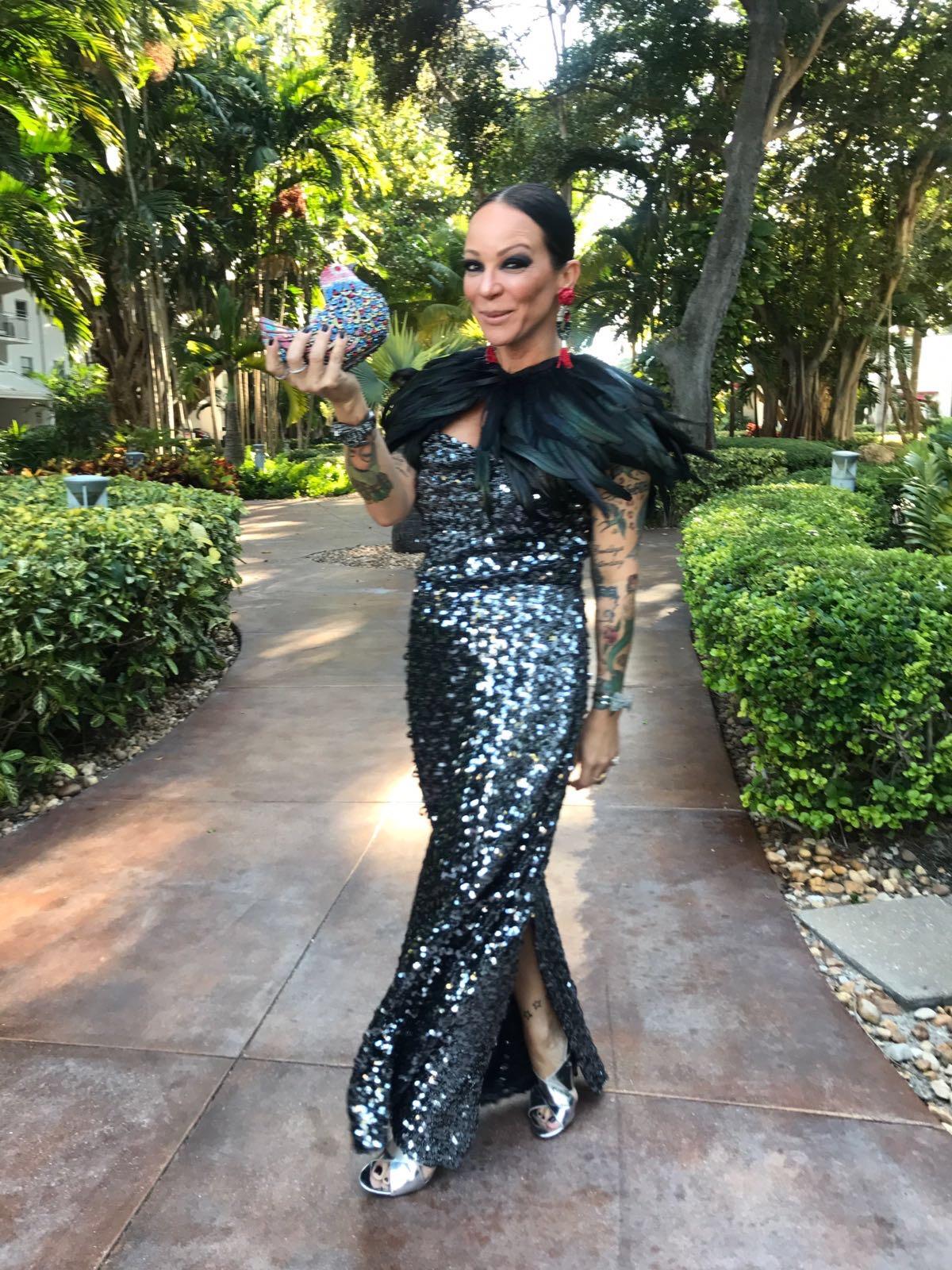 Carla McCarthy in a shiny black feather dress