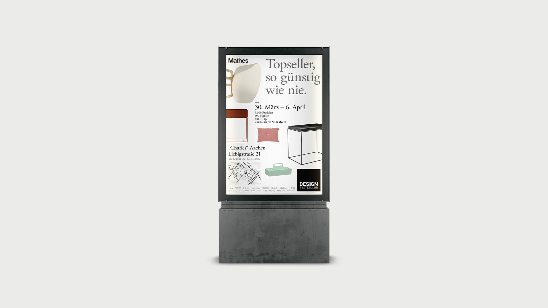 """Citylightposter im Leuchtkasten mit dem Claim """"Topseller, so günstig wie nie."""" der Werbekampagne für den Lagerverkauf von Design Bestseller."""