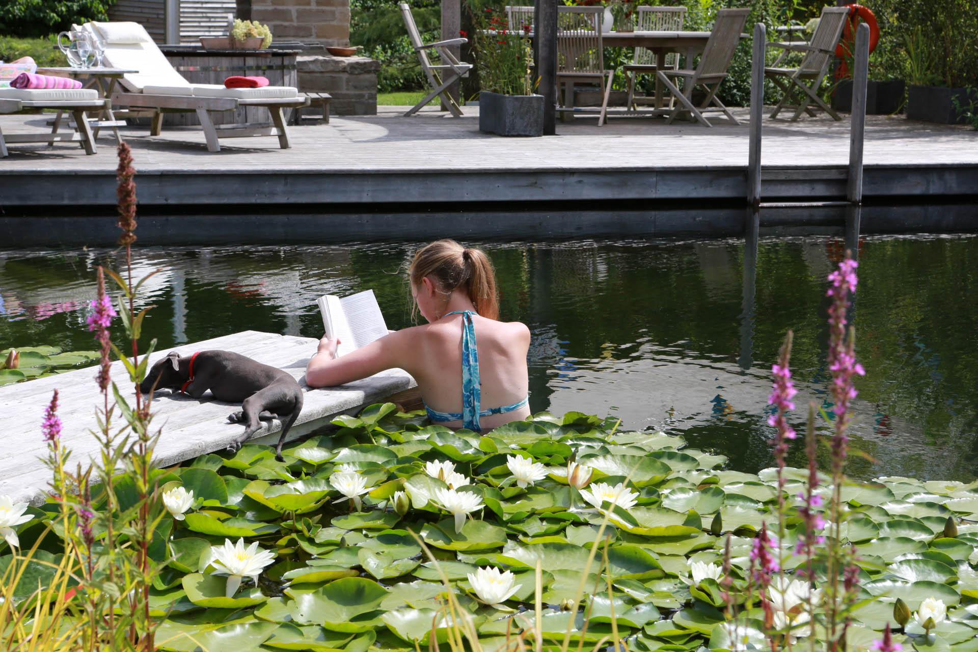 girl in natural pool