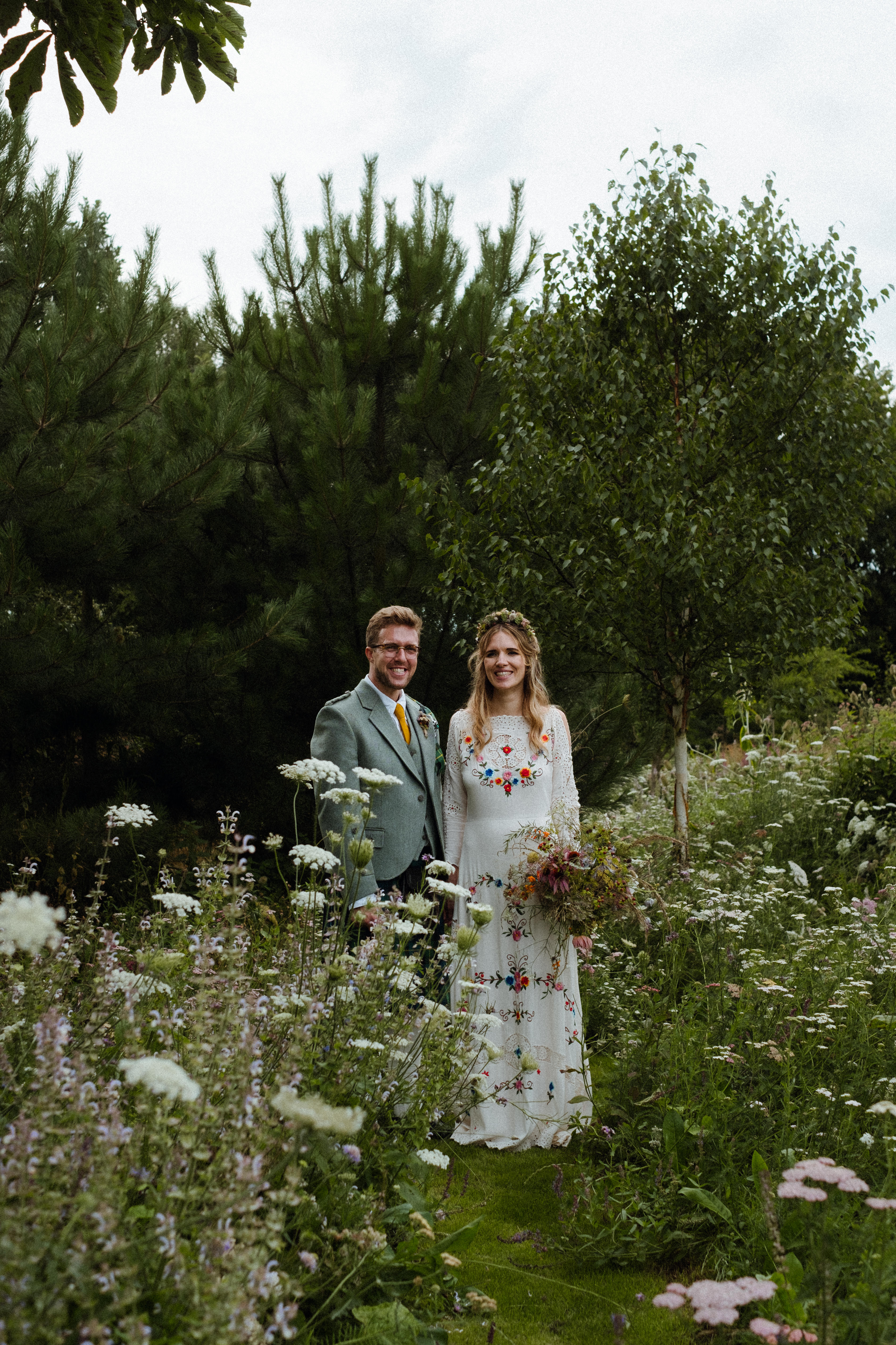 newly married couple in meadow