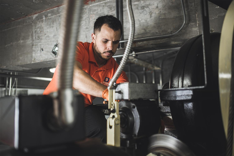 Brouss Elevators Technician working in the machine room