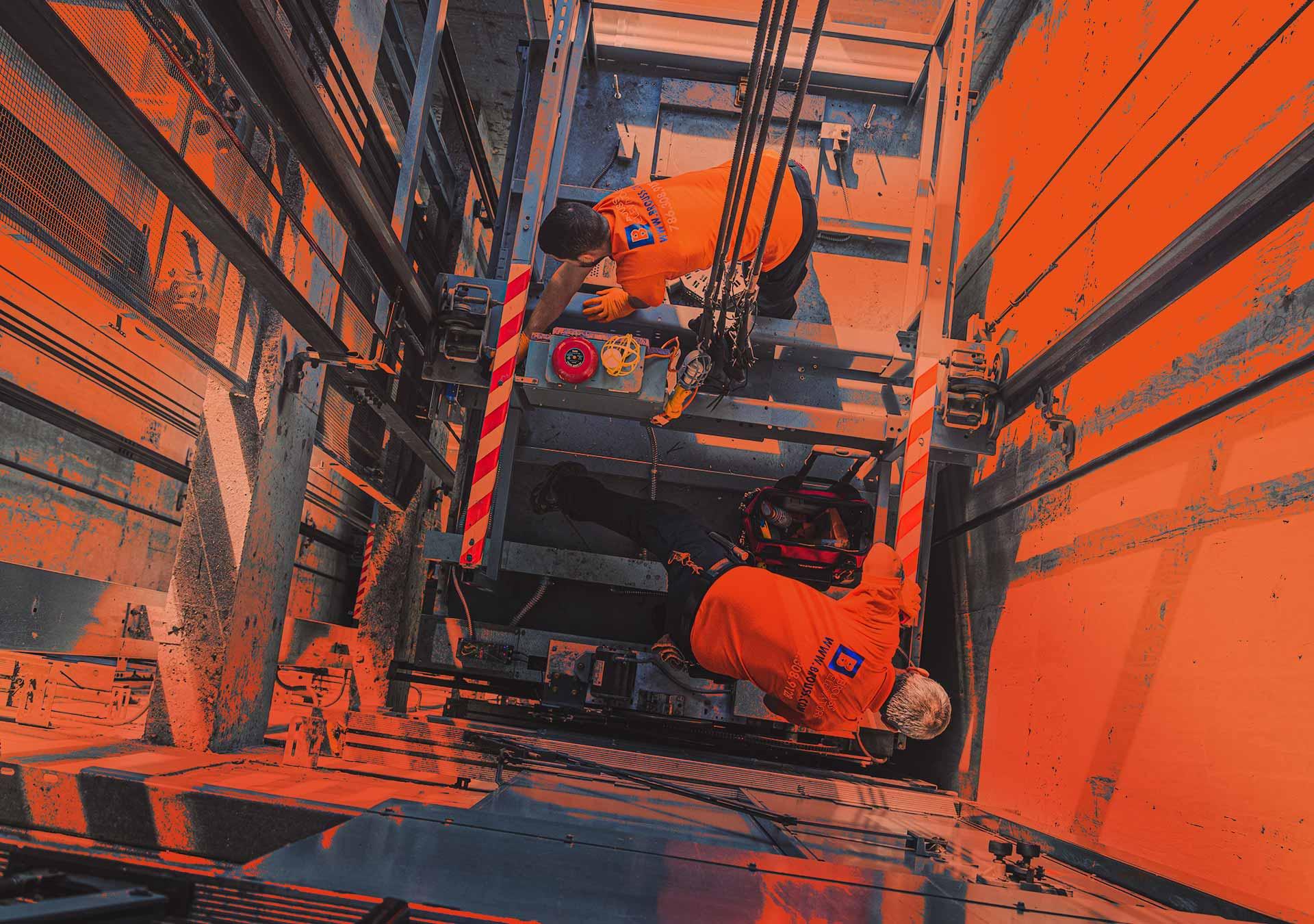 Brouss Elevators crew working on elevator Miami top view