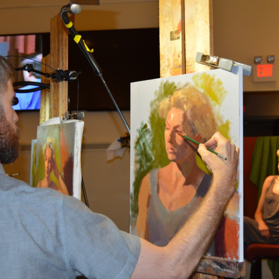 artist drawing a painting