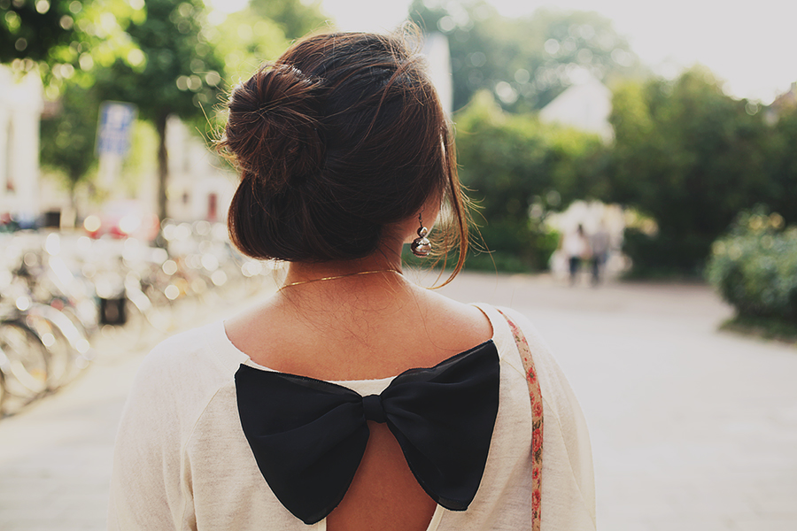 Girl with a bow sweater