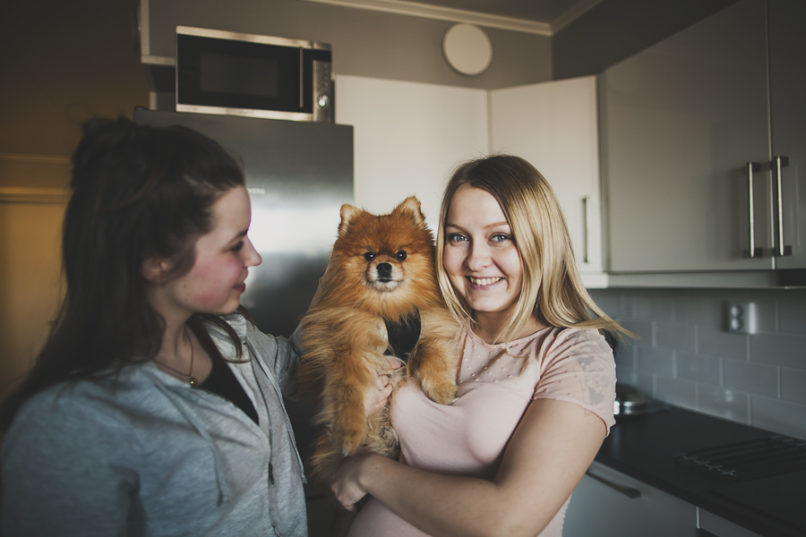 Girls and a dog smiling
