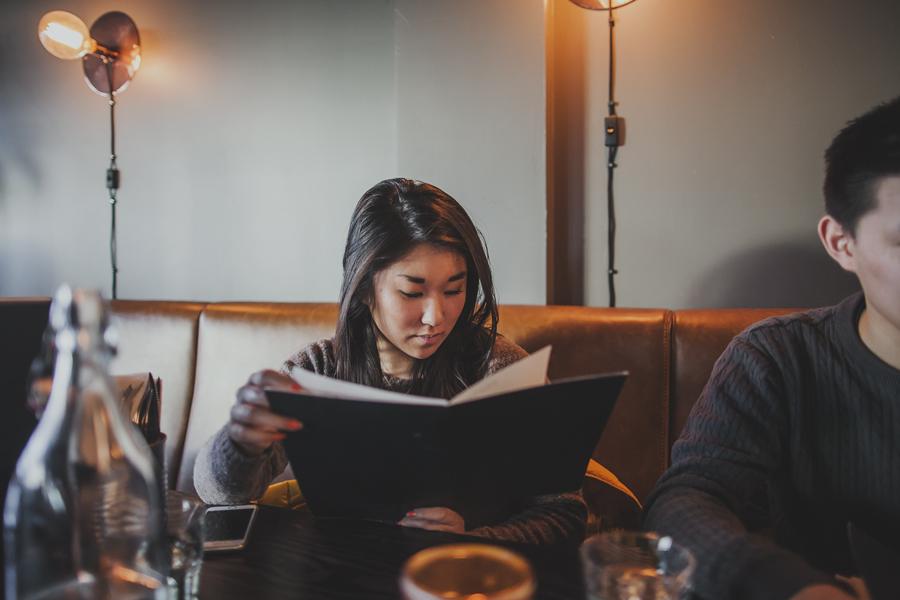 Girl looking at a menu