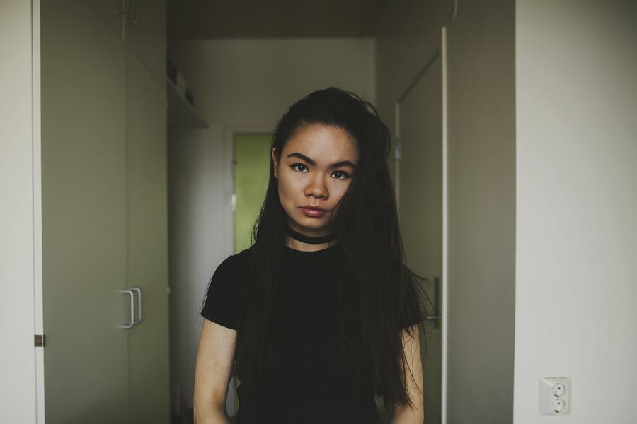 Girl wearing a black t-shirt and choker