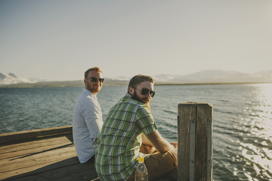 Boys sitting by the water