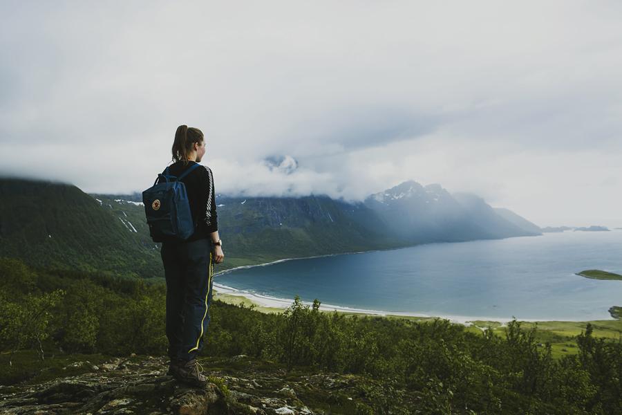 Girl hiking above Brennviksanden in Steigen