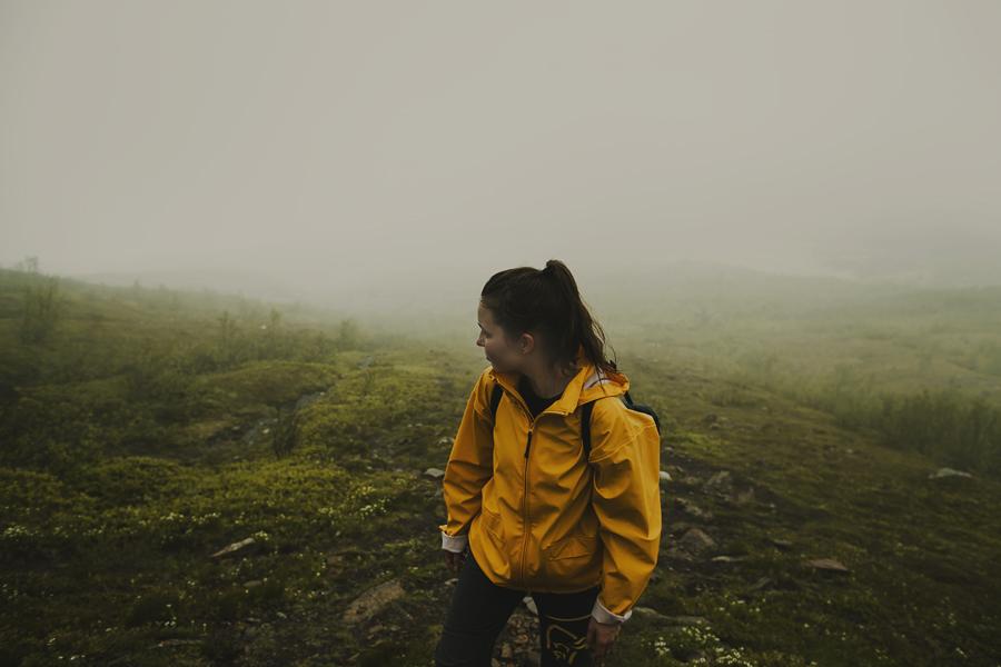 Girl hiking in fog