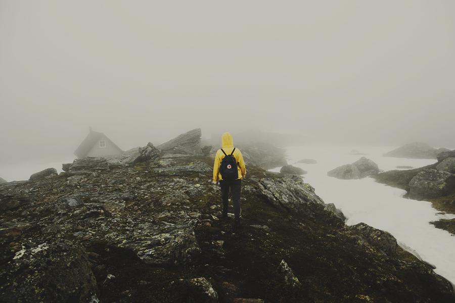 Girl hiking in the fog