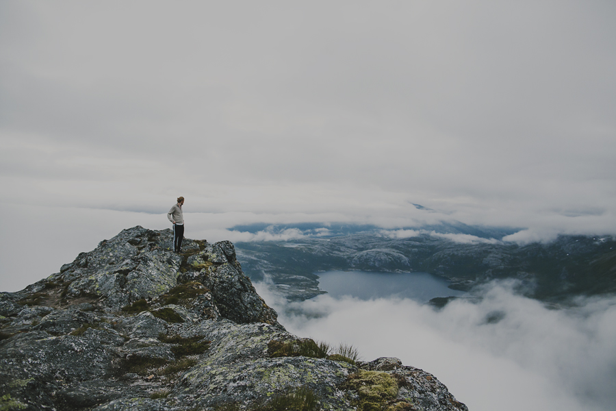 Boy looking at the fog covering the landscape