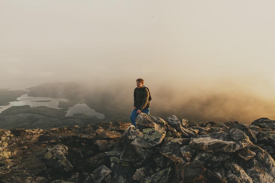 Boy hiking in sunset